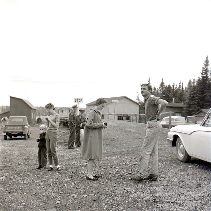 Johnny Cash is shown upon arriving in Millertown, N.L. on Oct. 8, 1961, in this photo by Richard Friske. Cash and his group were in the town to pick up supplies before heading to the logging camp at Victoria Lake that would be their base for a four-day moose hunting trip. In the background are local wildlife officers Harry Walters and Cecil Hall.