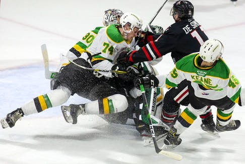 Ben Roger (74) gets involved in a collision with teammates and Jonah De Simone of the Niagara Ice Dogs in an Ontario Hockey League game on Oct. 27, 2019.