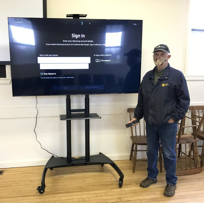 Bill Crossman, a volunteer at the Centrelea site, setting up the new TV for the sessions. Contributed