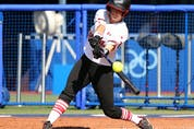 Kelsey Harshman #1 of Team Canada singles to left field in the fourth inning against Team Japan during the Softball Opening Round.