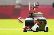 CHOFU, JAPAN – JULY 26: A robot delivers match balls on day three of the Tokyo 2020 Olympic Games at Tokyo Stadium on July 26, 2021 in Chofu, Tokyo, Japan.