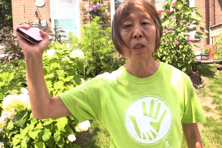 """Ruihua """"Audrey"""" Liu was bitten on her ankles and the back of her pants Monday (July 26, 2021) by a coyote which approached her outside her Scarborough home."""