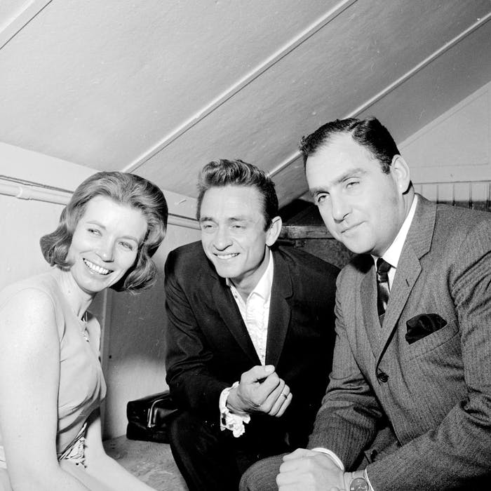 June Carter, Johnny Cash and Saul Holiff. — Postmedia file/London Free Press