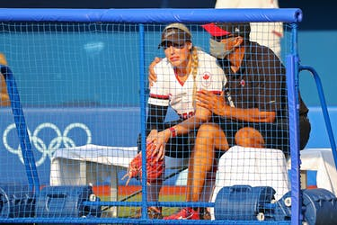 Canadian coach Mark Smith, of Falmouth, consoles pitcher Danielle Lawrie after a heart-breaking 1-0 loss to Japan at the Tokyo Olympics on Sunday. Canada will play Mexico for a bronze medal on Tuesday. REUTERS/Jorge Silva