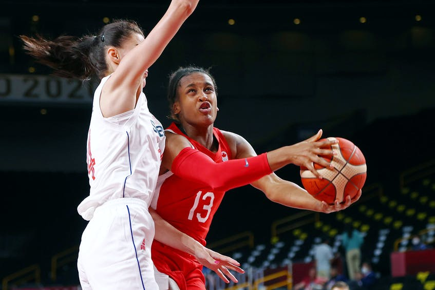 Shay Colley of Canada drives to the hoop against Serbia's Dragana Stankovic during opening action in women's basketball Group A at the Tokyo Olympics on Monday. Colley, originally from East Preston, scored 12 points in Canada's loss. - Brian Snyder/ Reuters
