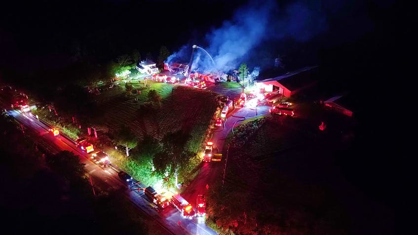 About two dozen fire departments were called to a blaze at meat house and butcher shop on Highway 14 in Upper Rawdon on Sunday night, July 26, 2021. - Adrian Johnstone