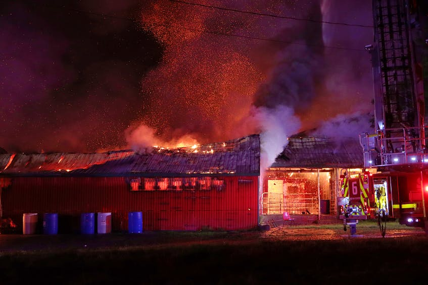 Firefighters from four counties were called to fight a fire at a meat house and butcher shop in Upper Rawdon, Hants County on Sunday night. - Adrian Johnstone
