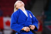 Canada's Jessica Klimkait reacts after defeating Slovenia's Kaja Kajzer in the judo women's -57kg bronze medal B bout during the Tokyo 2020 Olympic Games at the Nippon Budokan in Tokyo on July 26, 2021.