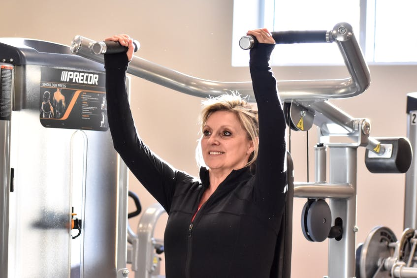 Laura Langille lifts weights at the Berwick Fitness Centre that is getting back into operation following a pair of closures brought on by COVID-19 restrictions. Contributed