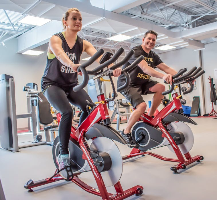Shawna and Kendall Morse ride the stationary bikes at the Berwick Fitness Centre that is looking to get back on track after two closures brought on by COVID-19. Contributed