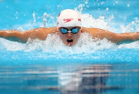 Maggie MacNeil, who has connections to New Waterford, captured Canada's first gold medal at the 2020 Olympic Games in Tokyo on Sunday night, finishing the women's 100-metre butterfly with a time of 55.59 seconds. REUTERS PHOTO.
