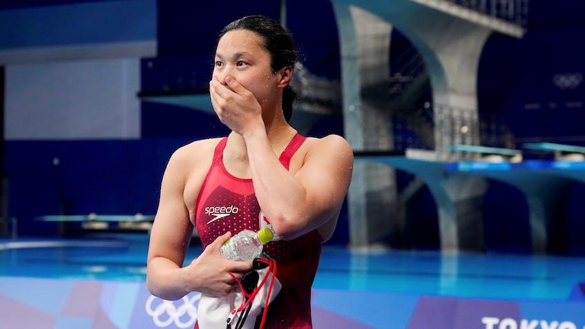 Maggie MacNeil of Canada reacts after winning the women's 100-metre butterfly on Monday. REUTERS/Aleksandra Szmigiel