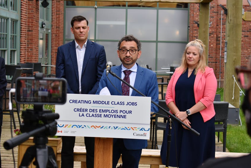 Transport Minister Omar Alghabra, centre, announced $3 million in federal funding for the Charlottetown Airport on July 26. Behind him, left, Doug Newson, CEO of the Charlottetown Airport authority, and Corryn Clemence, CEO of the Tourism Industry Association of P.E.I.