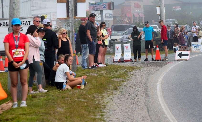 People watch and cheer on the runners near the finish line of the Nova Scotia Marathon, half marathon, 10k and 6k runs in Barrington Passage on July 25. KATHY JOHNSON