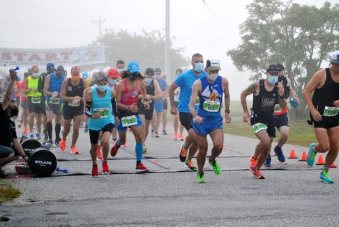 Runners leave the start line for the 50th  annual  Nova Scotia Marathon on July 25 in Barrington Passage. Herbie Sakalauskas (121), second from right was the overall full marathon winner posting a time of 2:47:37, while Andrew Stanley (128) from Waterloo, Ontario was second across the finish line with a time of 2:52:41. KATHY JOHNSON