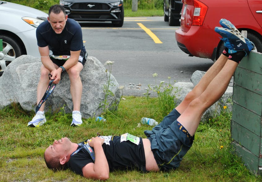Runners relax after completing the Nova Scotia full marathon. KATHY JOHNSON