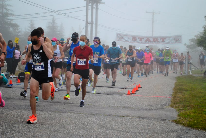 Runners in the Nova Scotia Half-Marathon leave the start line on Sherose Island. A field of 116 athletes competed in the race.  KATHY JOHNSON