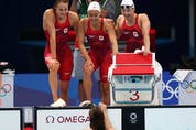 Kayla Sanchez of Canada, Margaret Mac Neil of Canada, Rebecca Smith of Canada and Penny Oleksiak of Canada celebrate after winning the silver medal.