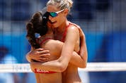 Sarah Pavan of Canada and Melissa Humana-Paredes of Canada celebrate winning their match against the Netherlands.
