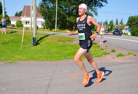 Mike Peterson of Charlottetown won the overall title in the 44th annual Callbeck's Home Hardware Dunk River Road Race in Bedeque for the third time in four years on July 25. Peterson's time was 44 minutes one second (44:01).