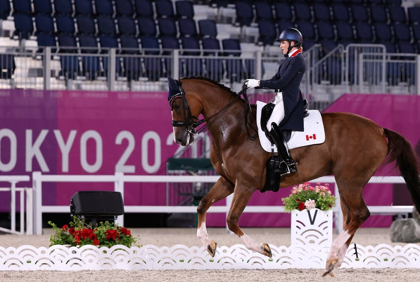 Brittany Fraser-Beaulieu New Glasgow  on her horse All In competes for Canada  in the Dressage Individual Grand Prix on Sunday at the Tokyo Olympics.  REUTERS/Alkis Konstantinidis