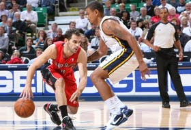 Earl Watson (right) defends Toronto's Jose Calderon during his playing days.