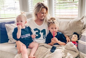 Angela Price, the wife of Canadiens goalie Carey Price, gets ready to cheer him on along with their daughters Liv, 4, and Millie, 1, from her parents' home in Kennewick, Wash., during 2020 NHL playoffs.