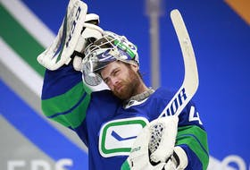 VANCOUVER, BC - APRIL 24: Braden Holtby #49 of the Vancouver Canucks looks on from his crease during their NHL game against the Ottawa Senators at Rogers Arena on April 24, 2021 in Vancouver, British Columbia, Canada.