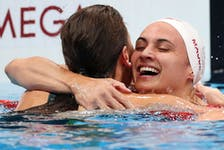 Kaylee McKeown of Team Australia is congratulated by Kylie Masse of Team Canada after winning the gold medal in the Women's 100m Backstroke Final on day four of the Tokyo 2020 Olympic Games at Tokyo Aquatics Centre on July 27, 2021 in Tokyo, Japan.