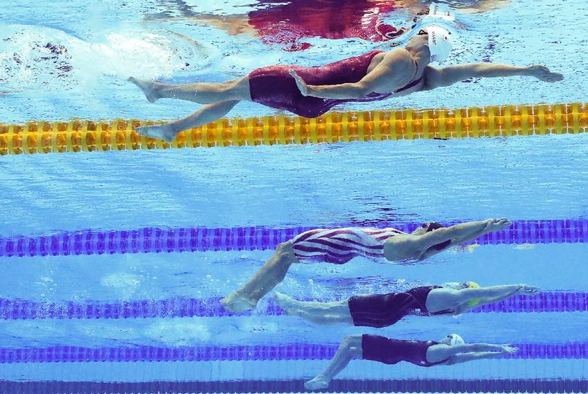Kylie Masse of Team Canada, Regan Smith of Team United States, Kaylee McKeown of Team Australia and Kathleen Dawson of Team Great Britain compete in the Women's 100m Backstroke Final on day four of the Tokyo 2020 Olympic Games at Tokyo Aquatics Centre on July 27, 2021 in Tokyo, Japan.