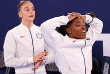 Grace McCallum and Simone Biles of Team United States react during the Women's Team Final on day four of the Tokyo 2020 Olympic Games at Ariake Gymnastics Centre on July 27, 2021 in Tokyo, Japan.