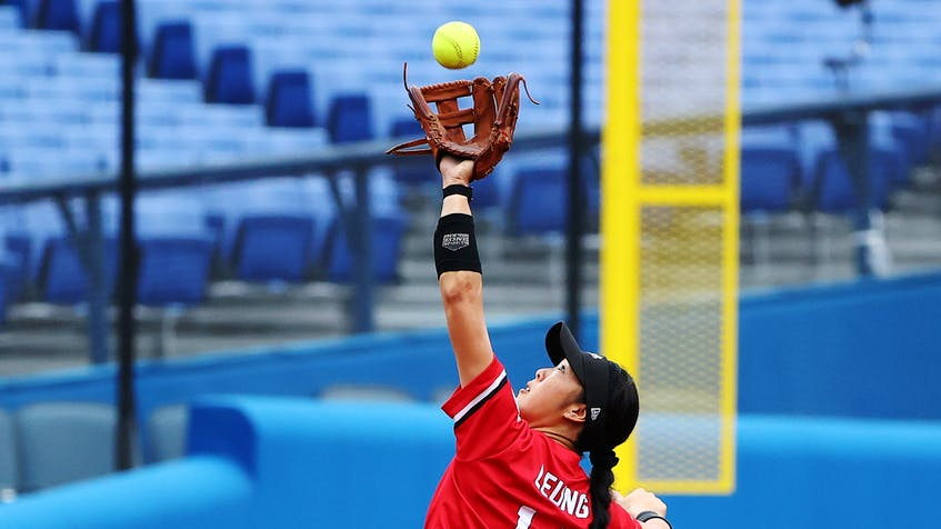 Janet Leung of Canada in action reaches for the ball during her team's bronze-medal women's softball game against Mexico on Tuesday, July 27, 2021 in Yokohama Baseball Stadium in Yokohama, Japan. - Jorge  Silva / Reuters