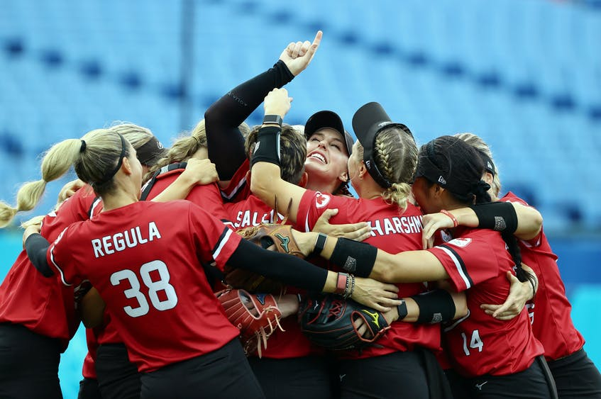 Canadian women's softball team players celebrate their win over Mexico in the bronze-medal game Tuesday, July 27, 2021, at the Yokohama Baseball Stadium in Yokohama, Japan at the Tokyo Olympics. - Jorge  Silva / Reuters