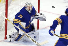 Buffalo Sabres goaltender Linus Ullmark (35) looks to make a save during the first period against the New York Islanders at KeyBank Center  on  Feb. 15, 2021.
