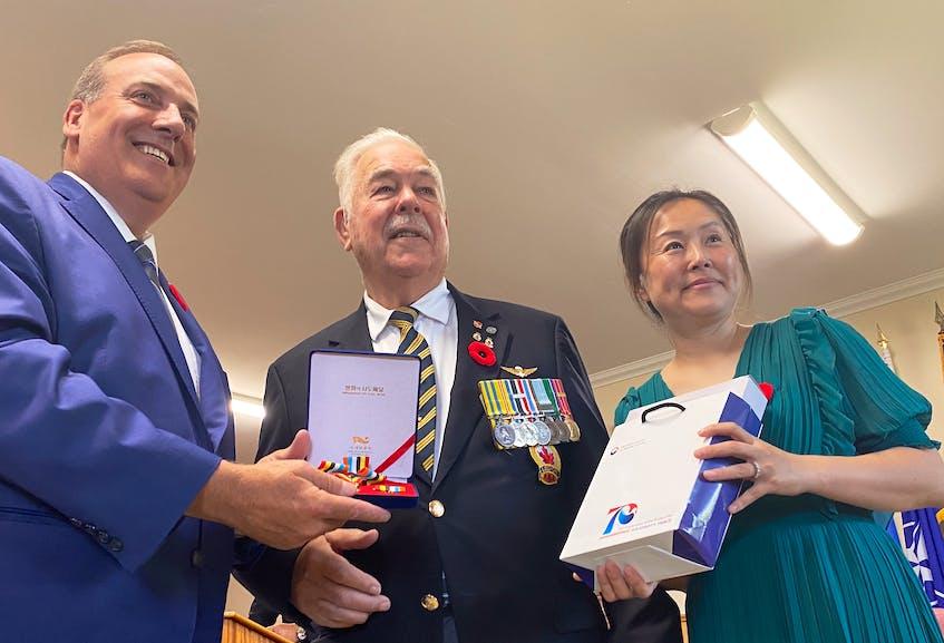 Korean War veteran Glendon Gavel is presented his Peace Medal and decorative towel. TINA COMEAU PHOTO