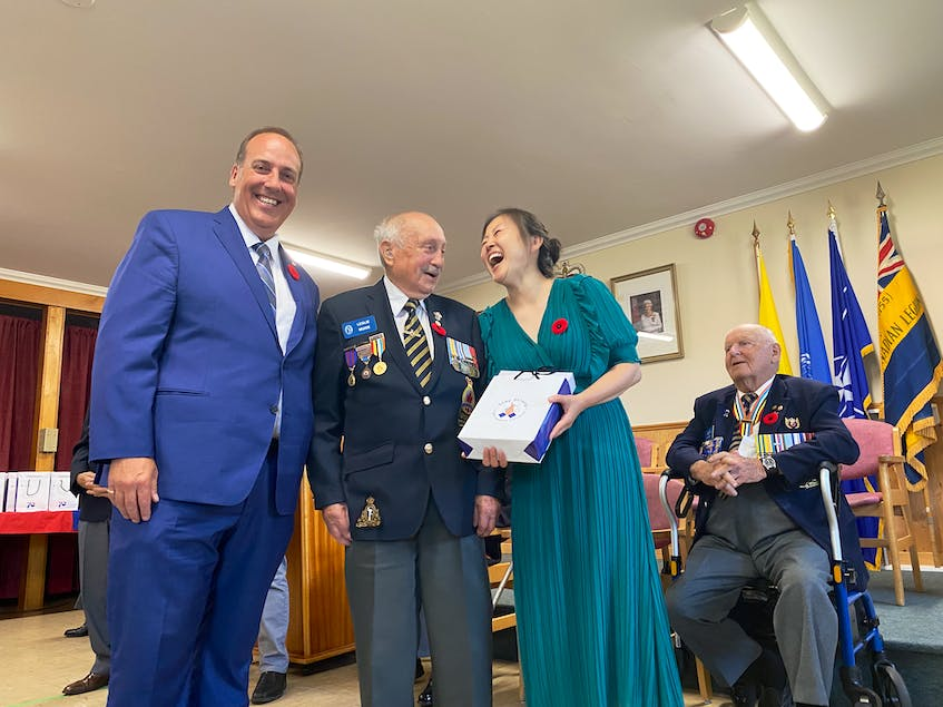 Korean War veteran Leslie Muise shares a laugh with Sonia Park-Lawrence during the ceremony. TINA COMEAU PHOTO - Tina Comeau