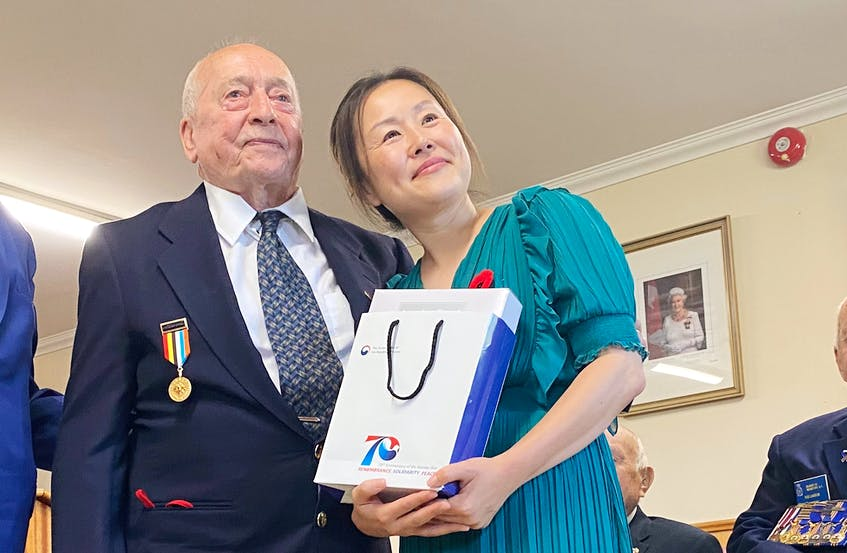 Korean War veteran Kenneth Jeffery receives his presentation during the ceremony. TINA COMEAU PHOTO