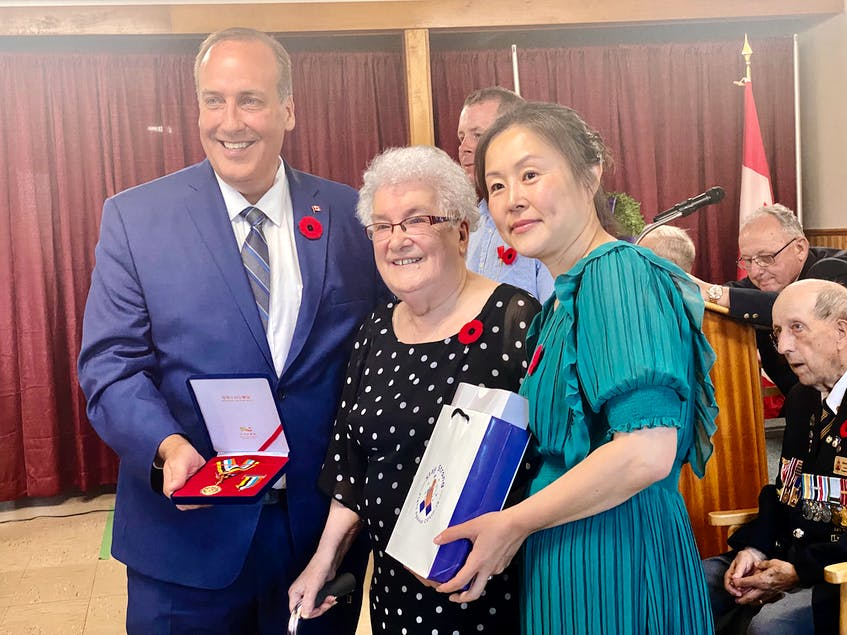 Cpl. David G. Pothier's wife, Rose Marie, accepted the medal and towels on behalf of her late husband, a veteran of the Korean War. Assisting in the presentation were West Nova MP Chris d'Entremont and Korean-born Yarmouth resident Sonia Park-Lawrence. TINA COMEAU PHOTO