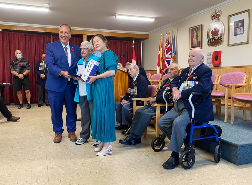 The family of the late Delphis J. Jacquard attended to receive his medal and towel, which were presented to his wife Mary. TINA COMEAU PHOTO