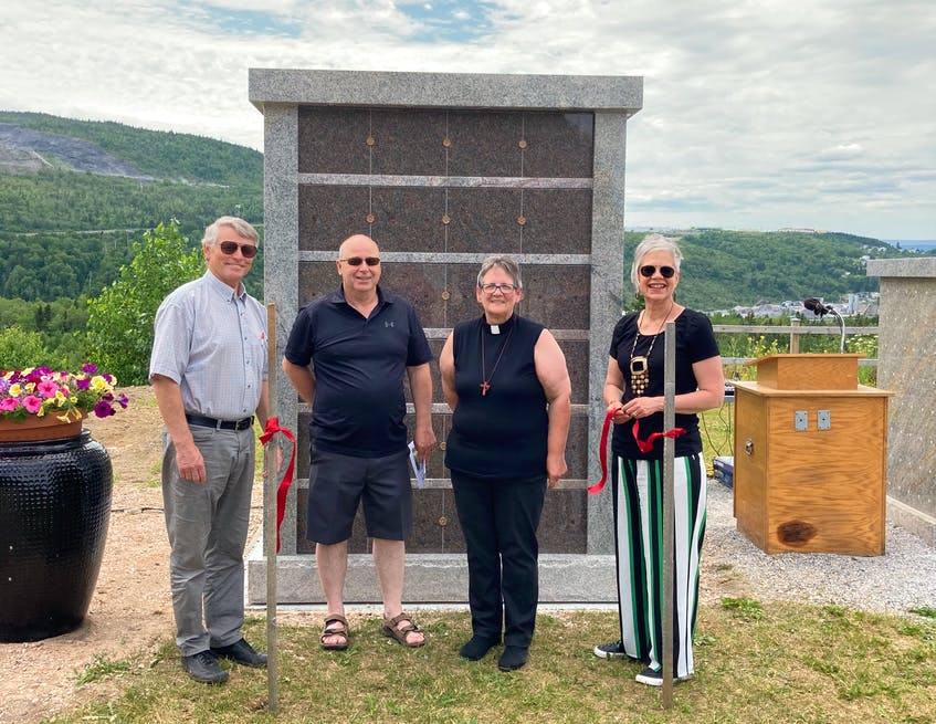 The second columbarium was dedicated at Mount Patricia Cemetery in Corner Brook recently. Taking part in the service were, from left, Lloyd Walters, treasurer of the cemetery association; Carl Bennett, cemetery association president; Rev. Catherine Short of the Bay of Islands Ministerial Association and Sonya Corbin Dwyer, cemetery association vice-president. - Contributed