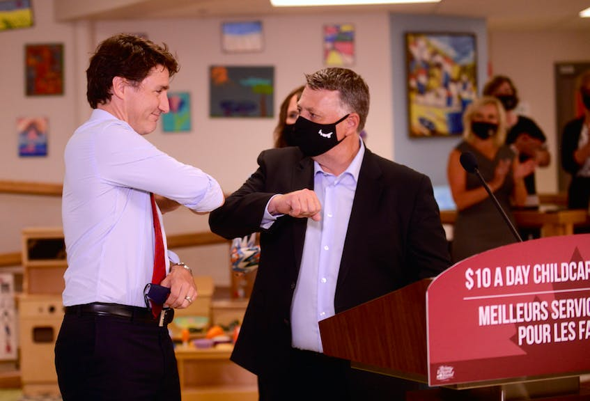 Prime Minister Justin Trudeau, left, and Premier Dennis King elbow bump during a joint federal-provincial government announcement July 27 in Charlottetown. - Jason Malloy