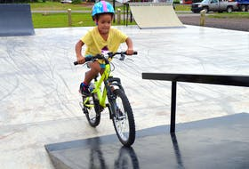 Danieka Mighty, 5, of Cornwall navigates one of the ramps on her bicycle at the town's skate park on July 26. She had lots of room to practise her skills as the park was quiet on a cloudy Monday morning.