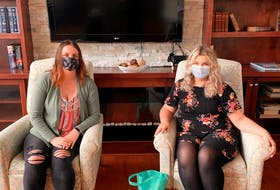 Brianne Burns from Maurices (left) sits with Parkland Truro's Bree-Lynn Pelly, with a bag of masks bought and donated by Maurices customers for Parkland residents. - Photo Contributed