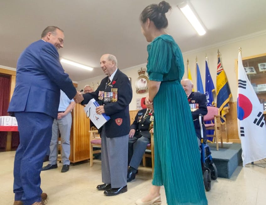 Korean War veteran Nelson Deveau smiles after his presentation in which he dabbled in some Korean. TINA COMEAU PHOTO