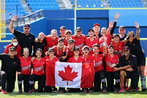 The Canadian women's softball team, including head coach Mark Smith of Falmouth, front row, right, celebrates after beating Mexico 3-2 to win the bronze medal at the Tokyo Olympics on Tuesday. REUTERS/Jorge Silva