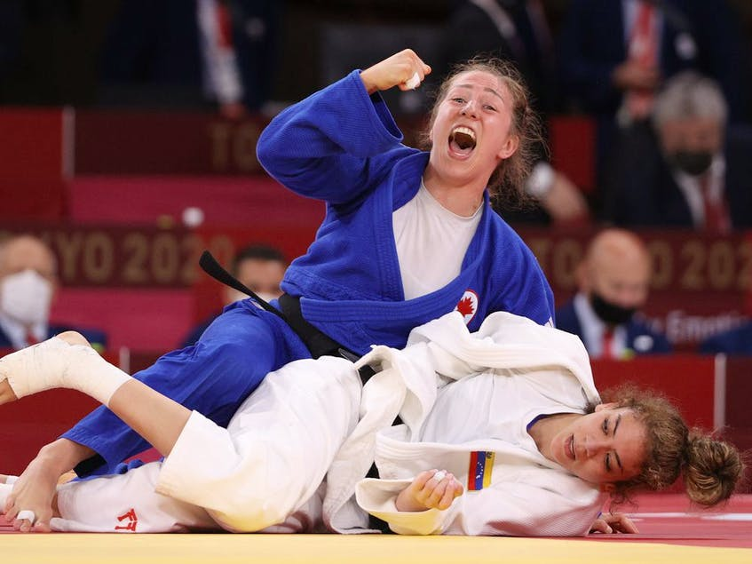 Catherine Pinard-Beauchemin of Team Canada celebrates after defeating Anriquelis Barrios of Team Venezuela on Tuesday, to win Canada's second bronze on the mats in as many days, this time in the under-63 kg women's weight class. - Harry  How