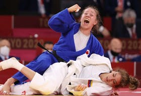Catherine Pinard-Beauchemin of Team Canada celebrates after defeating Anriquelis Barrios of Team Venezuela during the Women's Judo 63kg Contest.