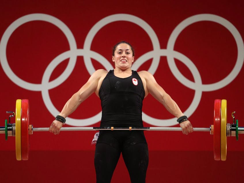Maude Charron of Team Canada competes during weightlifting in the women's 64kg weight class. - Chris  Graythen