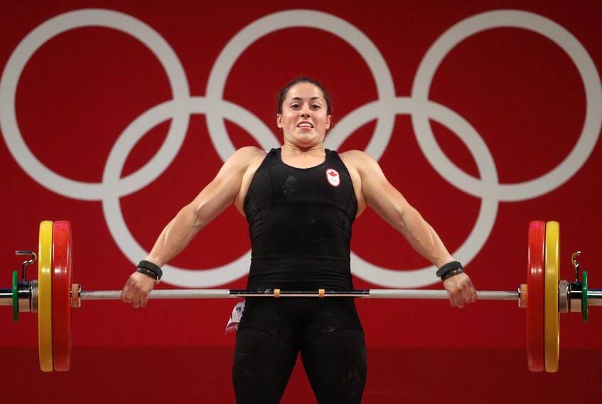 Maude Charron of Team Canada competes during weightlifting in the women's 64kg weight class.