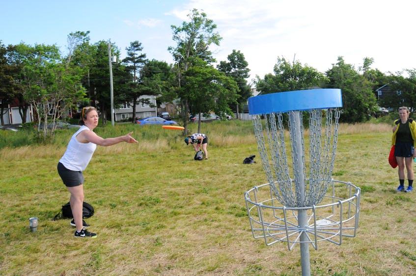Beth Beattie throws a disc at the new disc golf course across from the Confederation Building in St. John's. It was only her third time playing, but she enjoys the fact that it's outside and social.